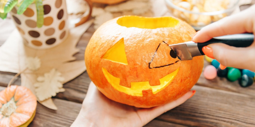 pumpkin carving with market and knife for safety